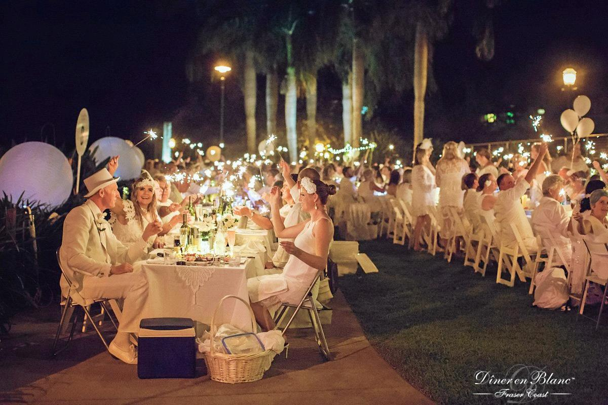 Dressed in white from head to toe, about 500 guests will travel to a secret location by bus for the second annual Le Diner En Blanc on November 10.