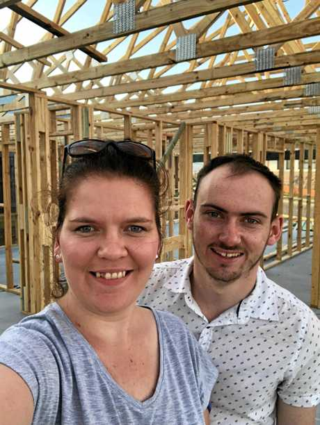DREAMS: Josh Wardell with partner Samara Thompson on the block of land where their house is currently under construction