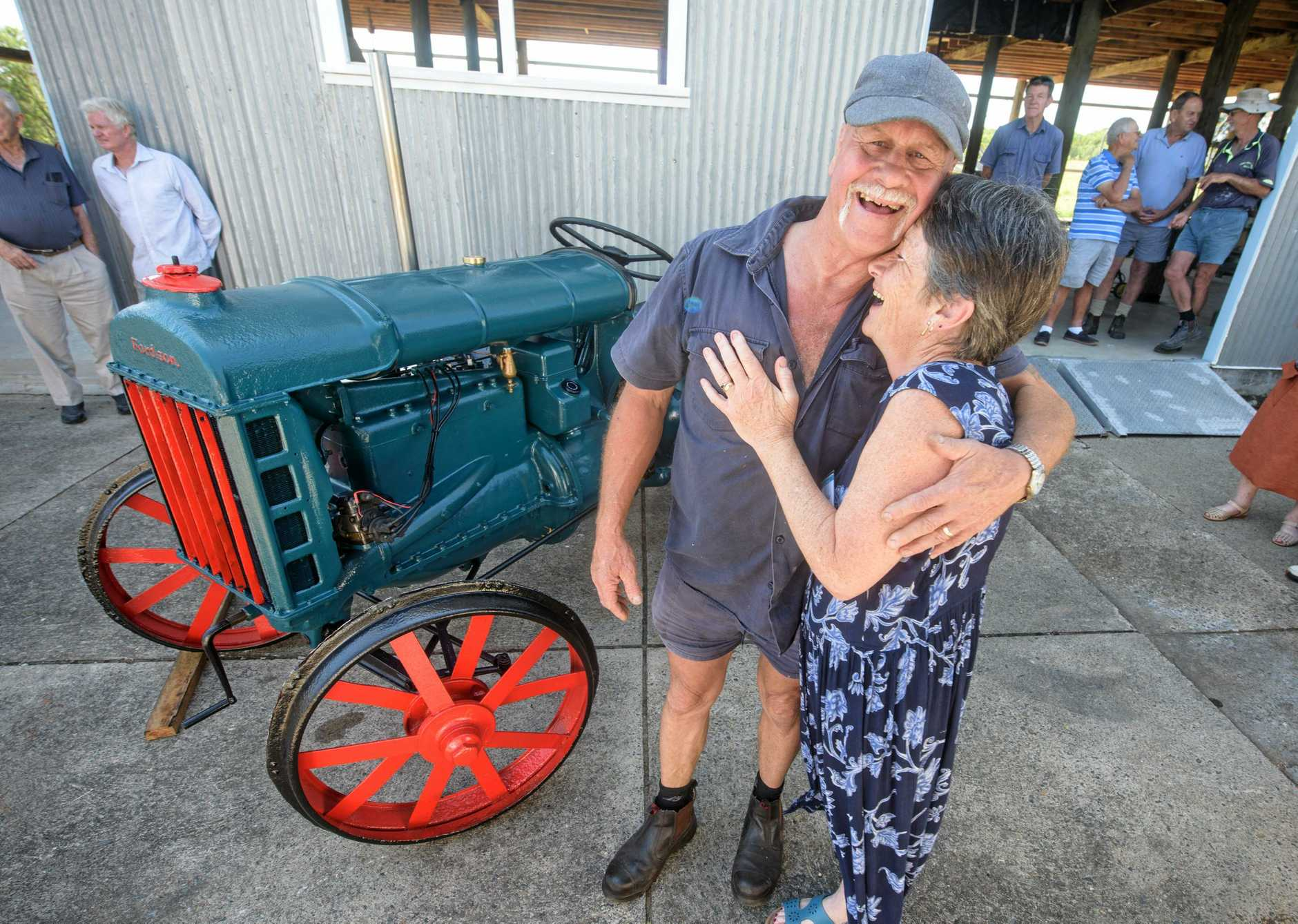 Geoff Bert gets a hug from his wife Sue after the historic tractor at the Lawrence Museum started for the first time in 50 years.