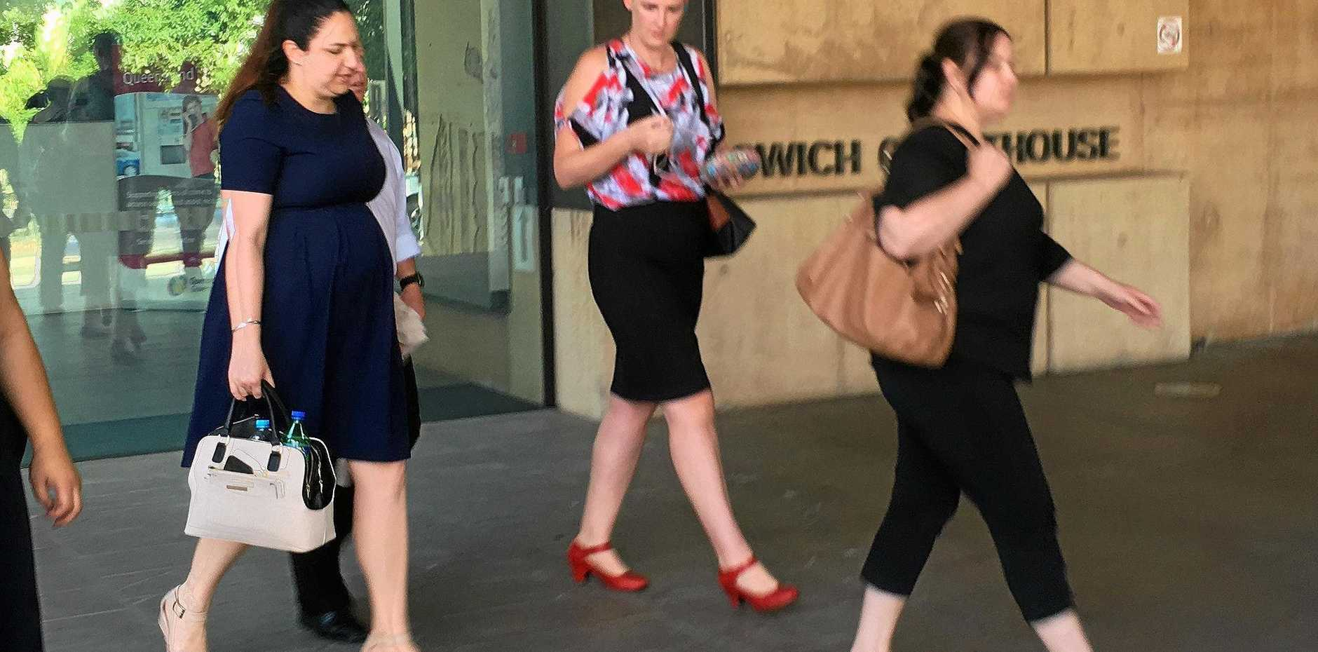 FREE: Nyala Johnston, left, leaves Ipswich Courthouse with supporters after a jury verdict found her not guilty of dangerous operation of a motor vehicle causing death of a woman in a Booval carpark.