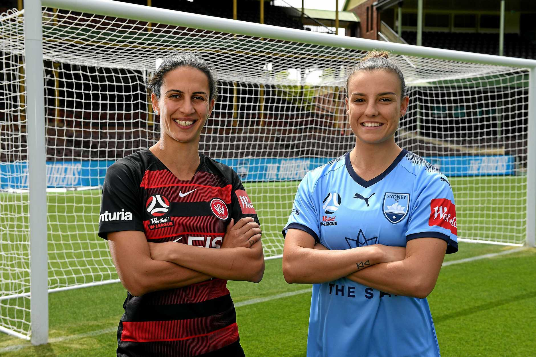Leena Khamis of the Western Sydney Wanderers and Chloe Logarzo of Sydney FC ahead of Thursday night's clash.