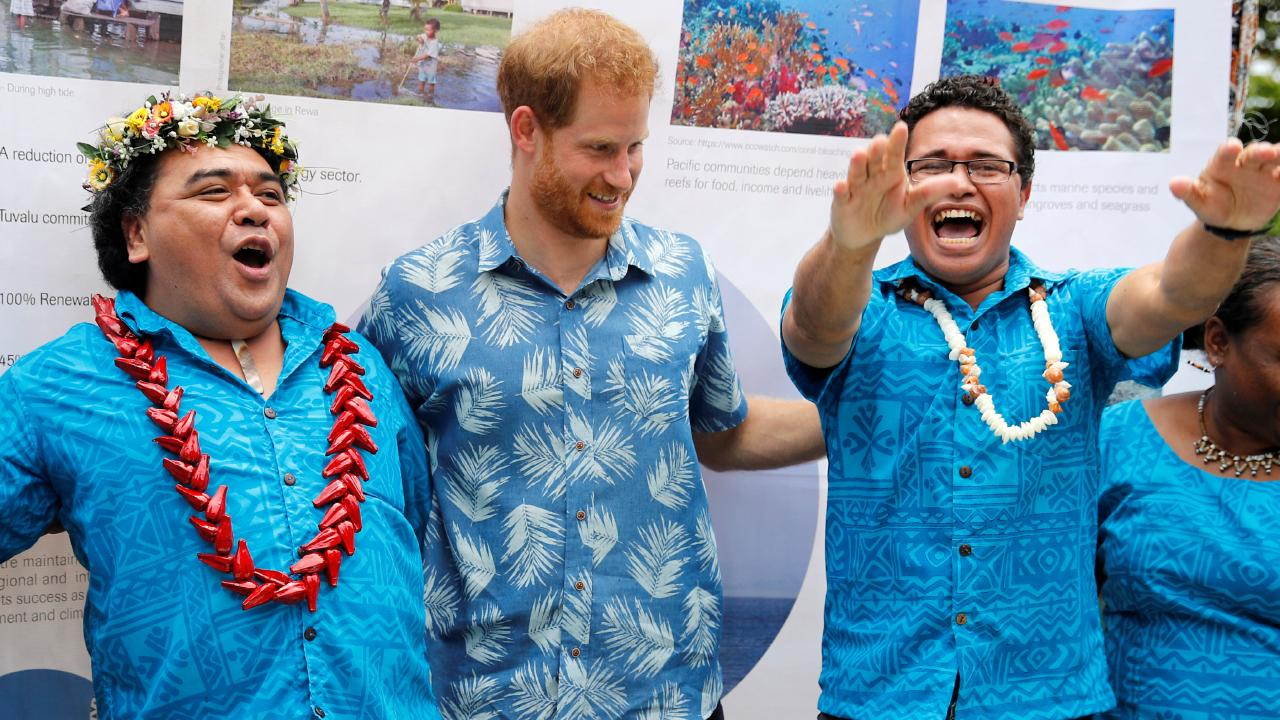 Prince Harry meets enthusiastic students at the University of the South Pacific in Suva, Fiji. Picture: Phil Noble.
