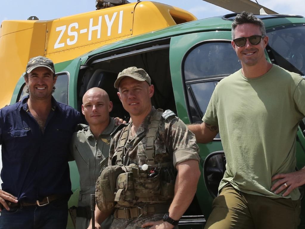 Wright with Pietersen and helicopter crew in South Africa.