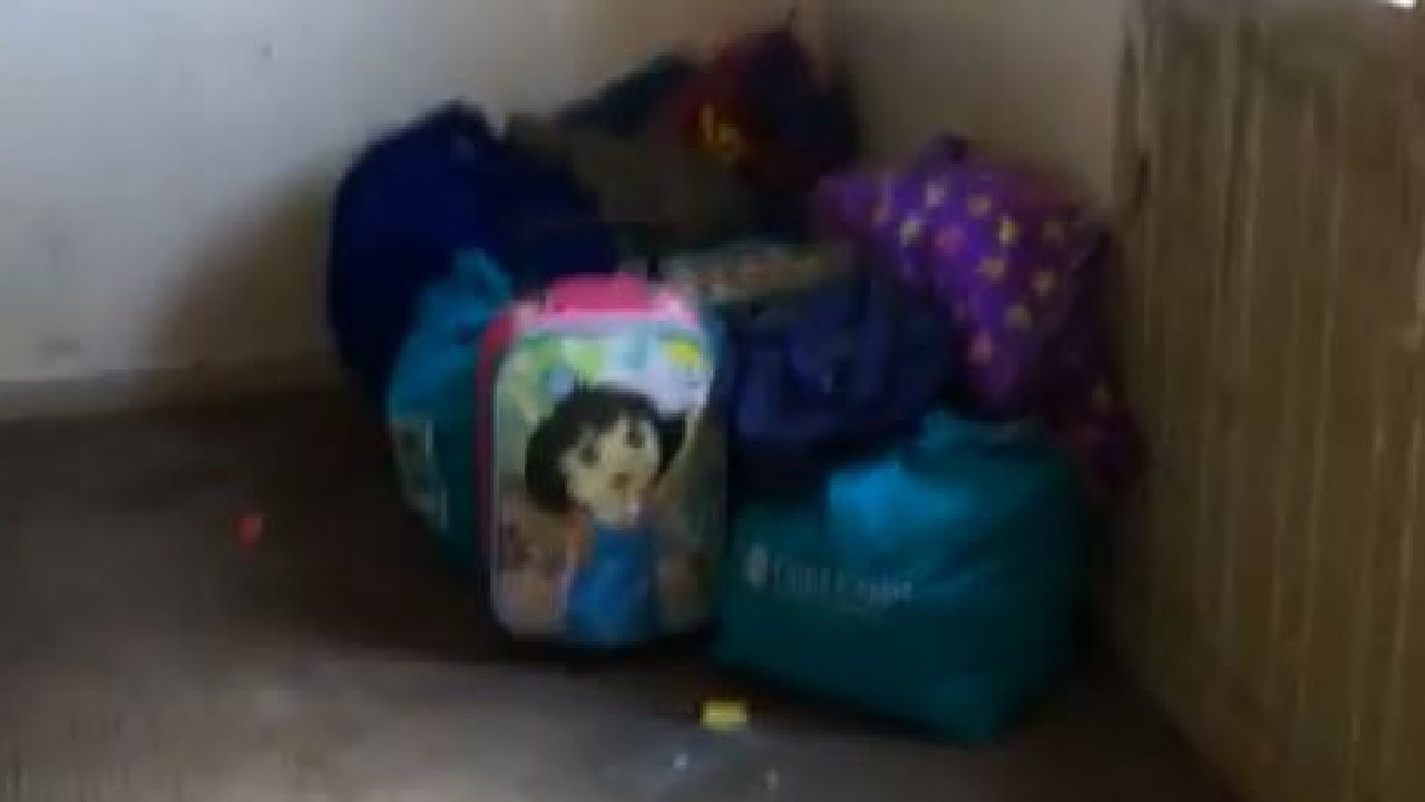 A Dora the Explorer bag among piles of junk in a Southport squat house where thousands of needles were found.
