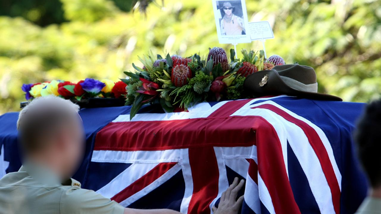 Signaller Sean McCarthy is laid to rest in a military service in Australia.
