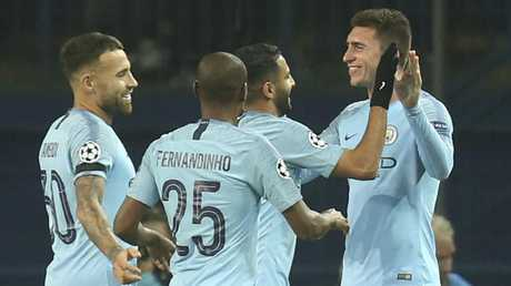 Aymeric Laporte is congratulated after scoring. (AP Photo/Efrem Lukatsky)