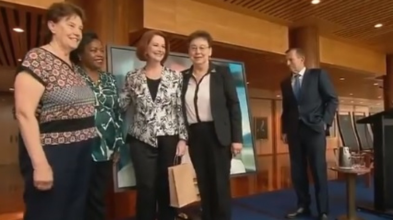 Tony Abbott awkwardly waiting to greet Julia Gillard.