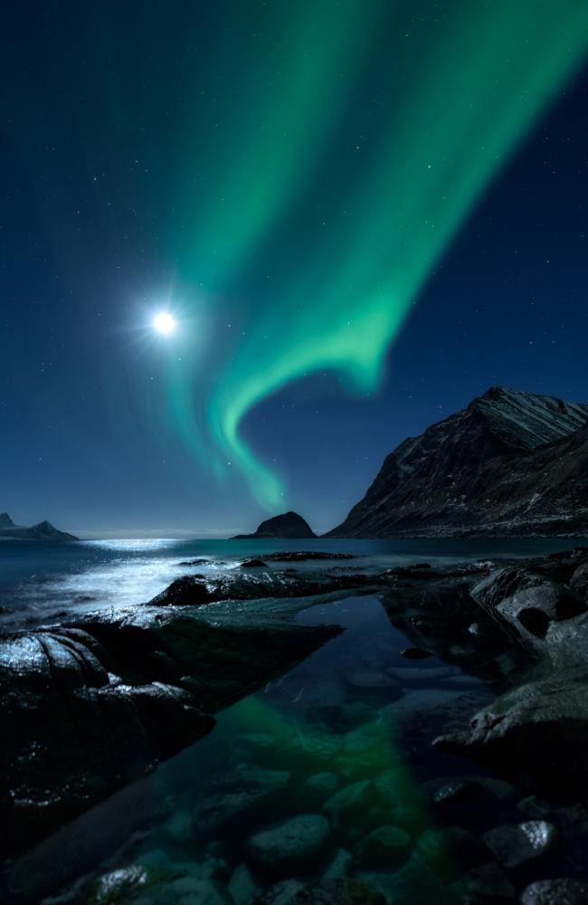 A breathtaking aurora borealis above the fjord in the gorgeous Lofoten archipelago, in Northern Norway — captured by Denmark's Mikkel Beiter. Picture: Supplied