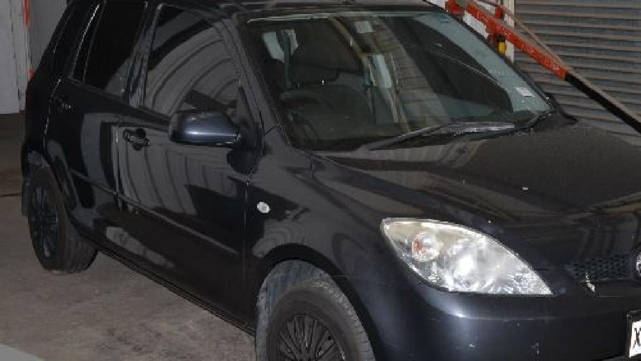 The dead man's car, a grey 2006 Mazda 2 sedan, was taken from the Para Vista property and found in a nearby street.