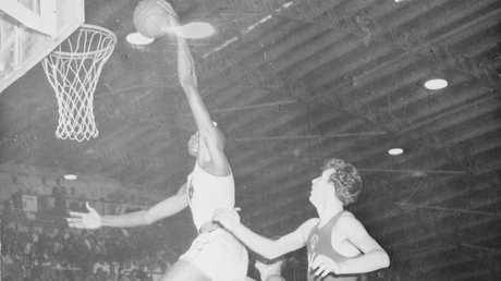 An American player dunks over his Russian opponent at the 1956 Melbourne Olympics.