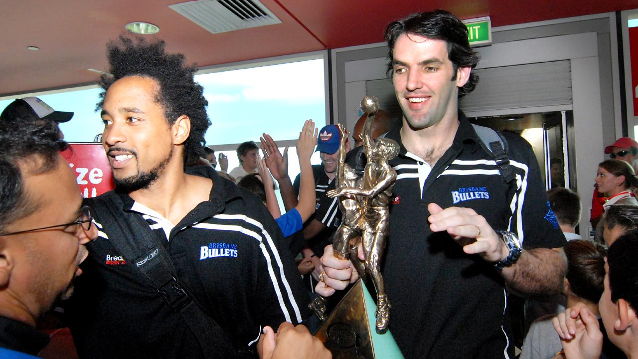 CJ Bruton and Sam Mackinnon arrive at Brisbane Airport after their 2007 title.
