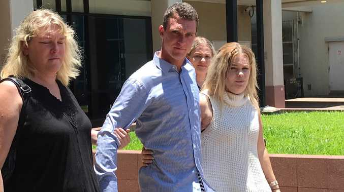 Convicted dangerous driver Daniel Cronn (blue shirt), who caused grievous bodily harm to Scott Kruger, has been spared actual jail time. He leaves the Cairns court house with his loved ones after being handed a wholly suspended term of imprisonment.