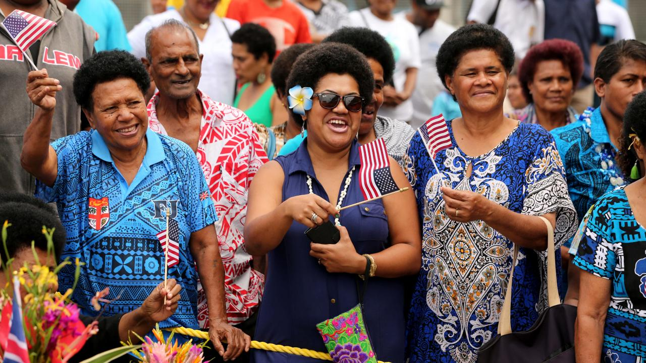 Fijians celebrate on the streets the tour of the Duke and Duchess of Sussex. Picture: Nathan Edwards.