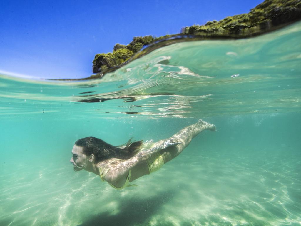 Brisbane model Ashleigh Allerton takes a dip at Tallebudgera Creek wearing She Made Me swimwear. Picture: Nigel Hallett