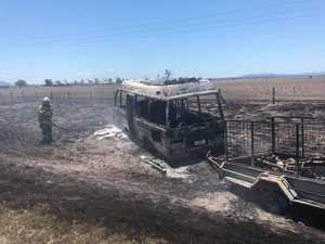 Mini-bus, trailer burnt out after crash