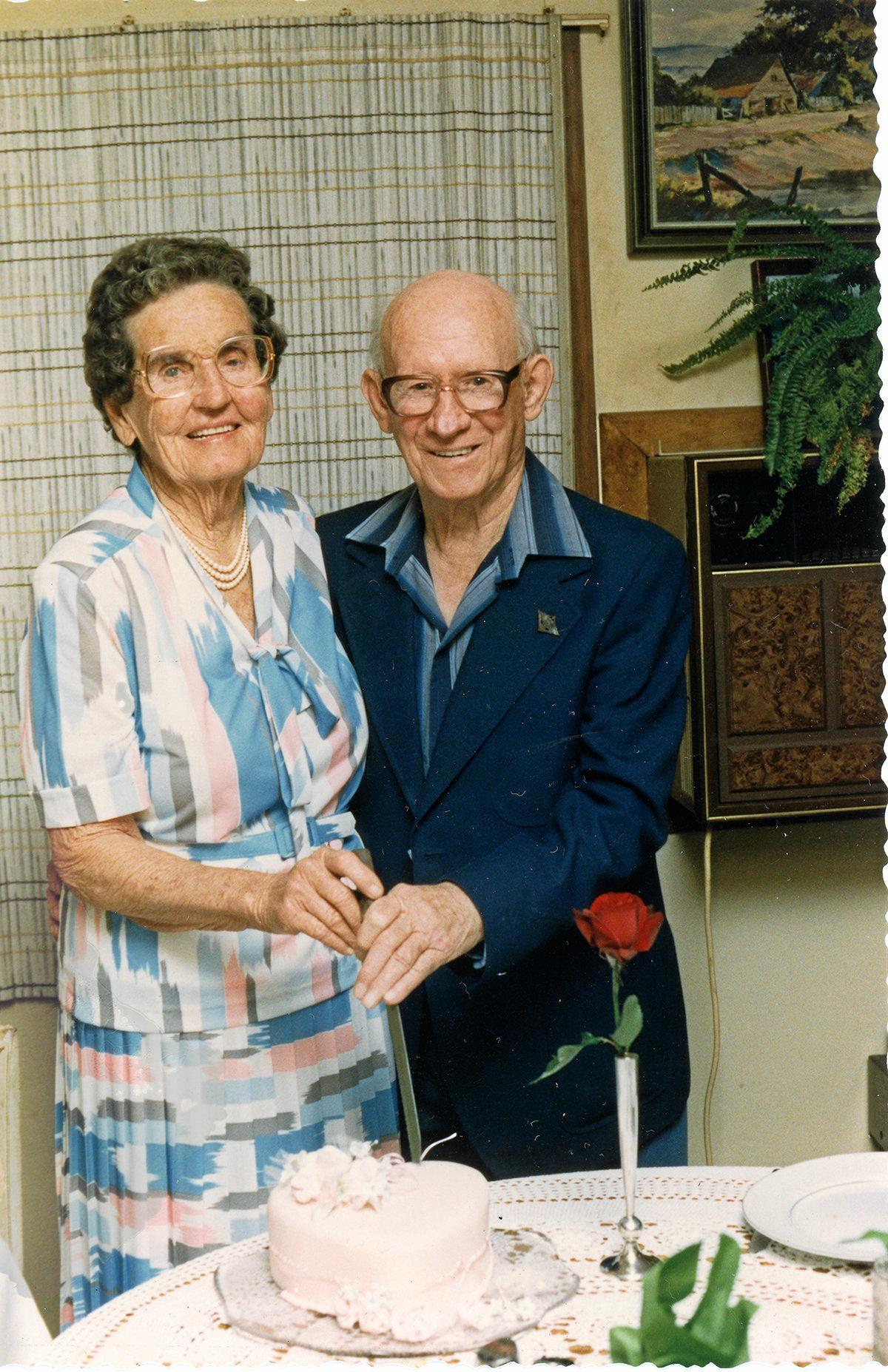 Ella and Lionel Mitchell cut the cake on their diamond wedding anniversary, 1987.