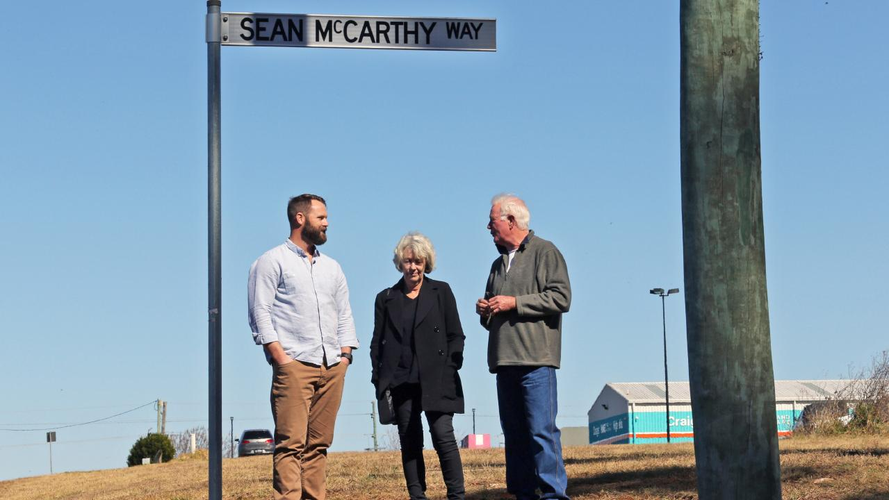 Sean McCarthy's parents Mary and David with Johnathan on a local street named after Sean. Picture: Gary Ramage