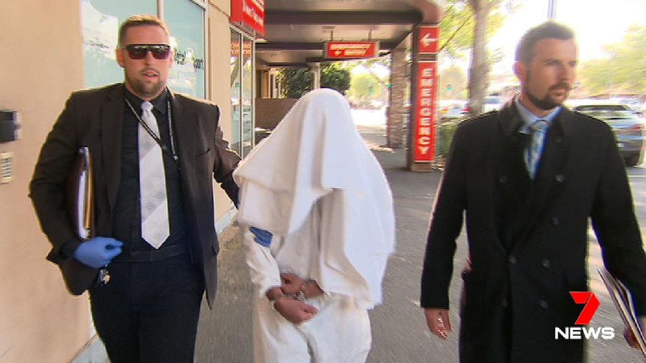 The murder suspect leaves Calvary Wakefield Hospital with two detectives. Picture: 7 News Adelaide