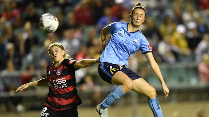 Rosie Sutton (left) of the Wanderers competes for possession with Sydney FC's Rachael Soutar at Marconi Stadium on Thursday night. Picture: AAP