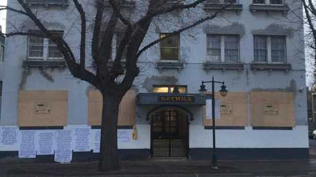 Apartments in the former rooming house are poised for auction. Picture: Fiona Byrne
