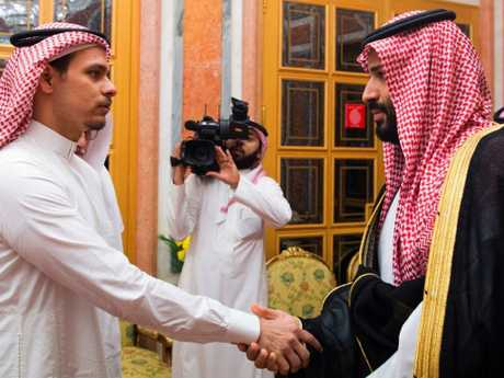 Saudi Crown Prince Mohammed bin Salman, right, offer condolences as he shakes hands with Khashoggi's son Salah. Picture: Saudi Press Agency via AP