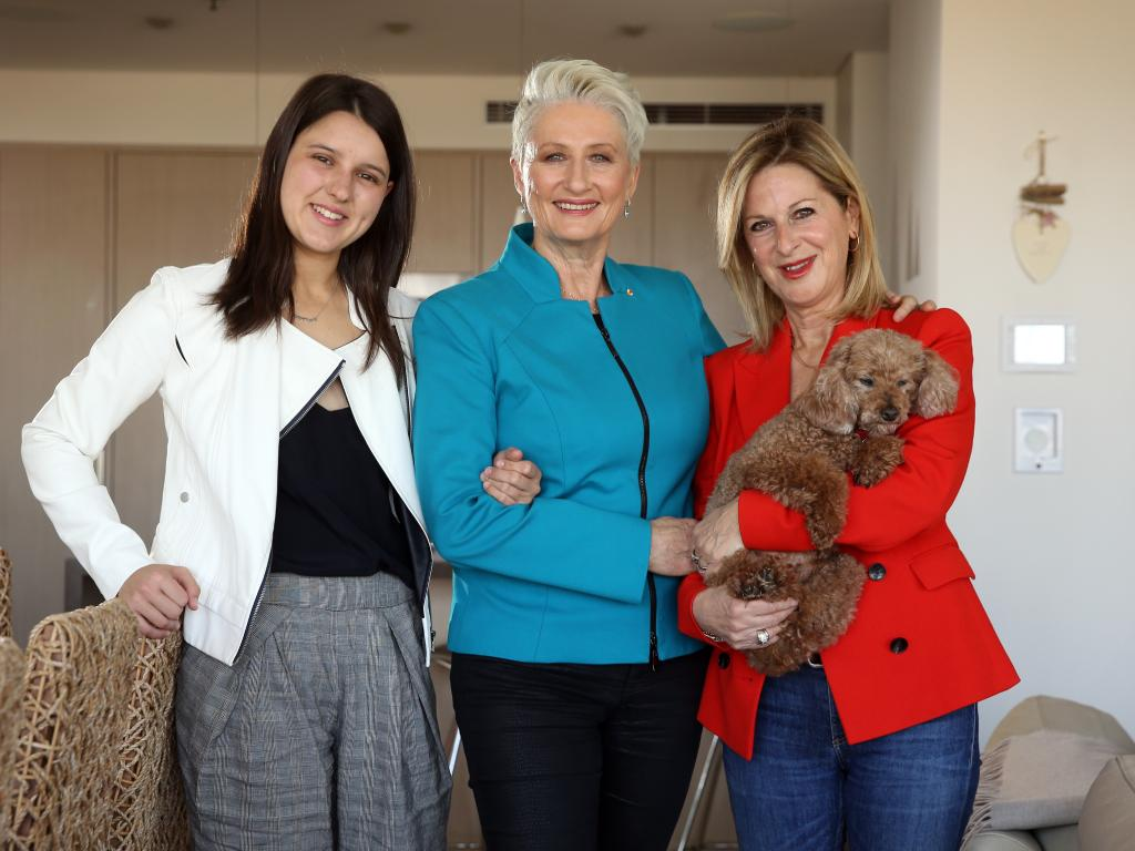 Kerryn Phelps with partner Jackie Stricker-Phelps, right, and daughter Gabrielle at their Potts Point home. Picture: Sam Ruttyn
