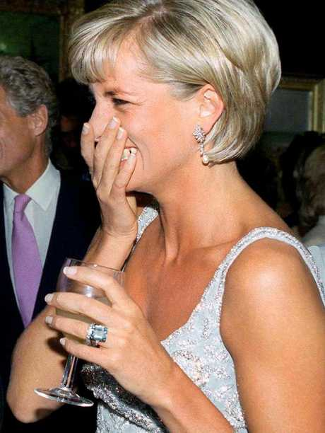 Princess Diana wearing the aquamarine ring Prince Harry has given to Meghan.