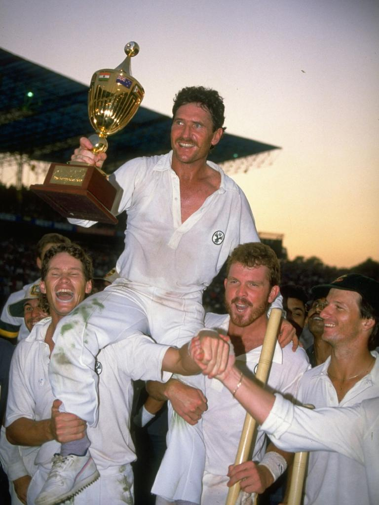 Dean Jones (L), Craig McDermott and Steve Waugh (far R) hold up captain Allan Border after winning the 1987 World Cup.