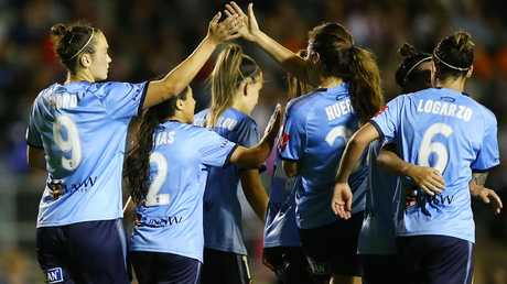 Sydney FC's Caitlin Foord (left) celebrates after scoring against Western Sydney Wanderers on Thursday night. Picture: Getty Images