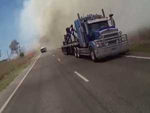 Video captures dramatic grass fire rescue