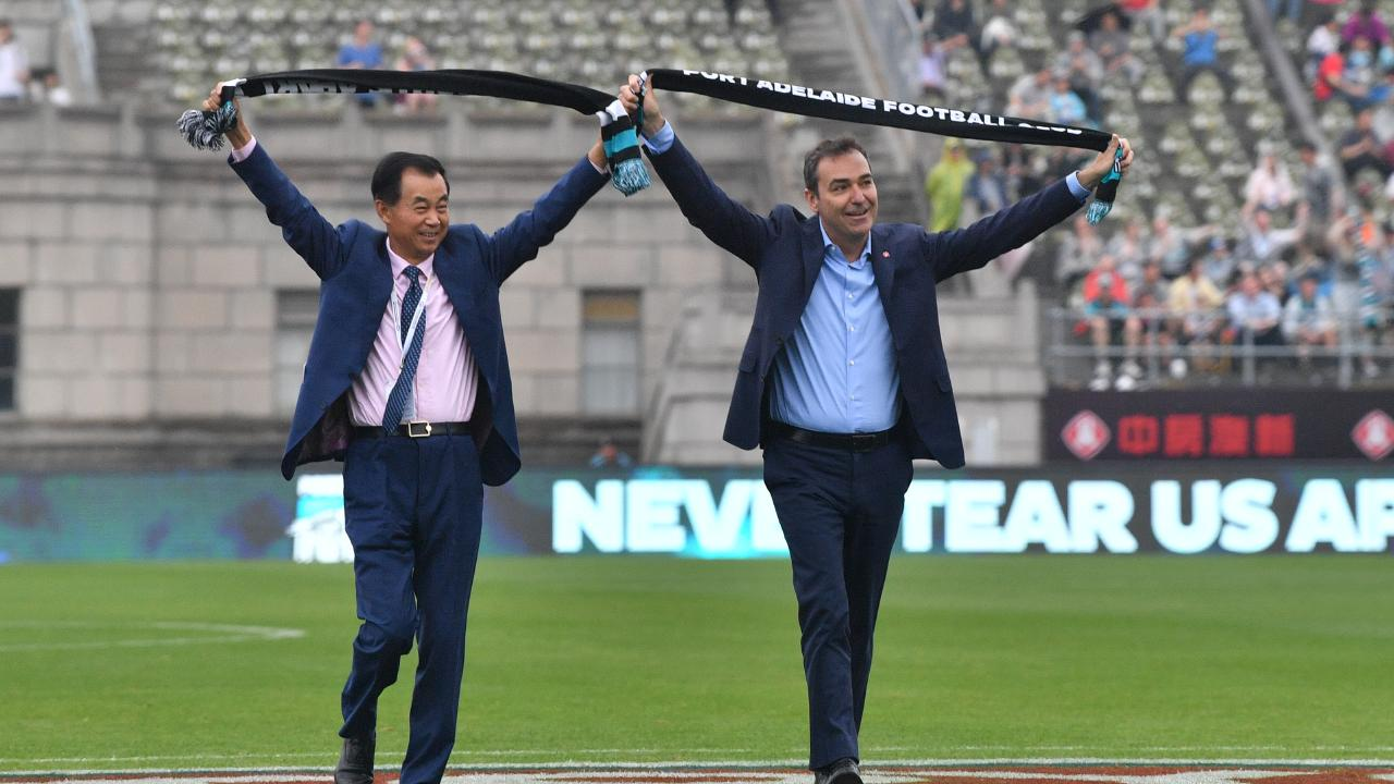South Australian Premier Steven Marshall, right, in Shanghai for the Port Adelaide China game this year. His Victorian State government colleagues have delivered St Kilda as the Power's new opponent in China for the next three years. Picture: David Mariuz
