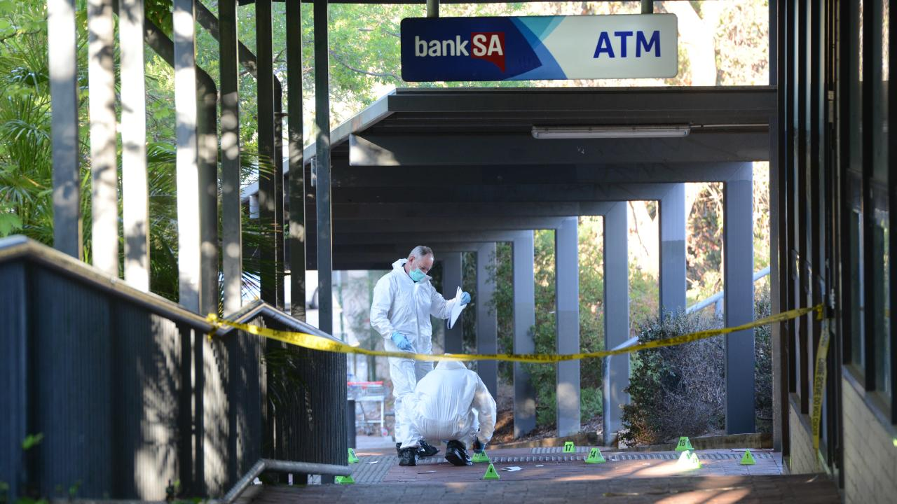 Forensic and crime-scene investigators at the scene of the murder. Picture: AAP / Brenton Edwards