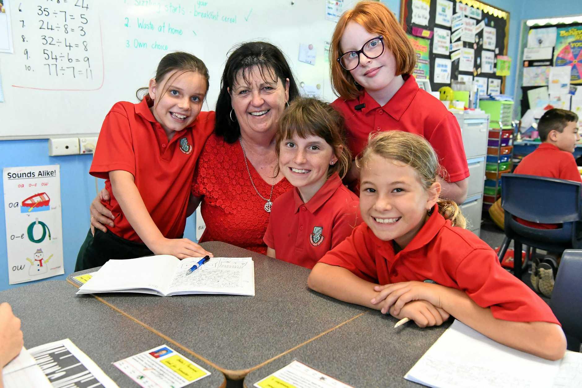 WORLD TEACHERS' DAY: Sophie Duxbury, teacher Kerry Haynes, Bridget Mason, Alana Reid and Maya Gough.