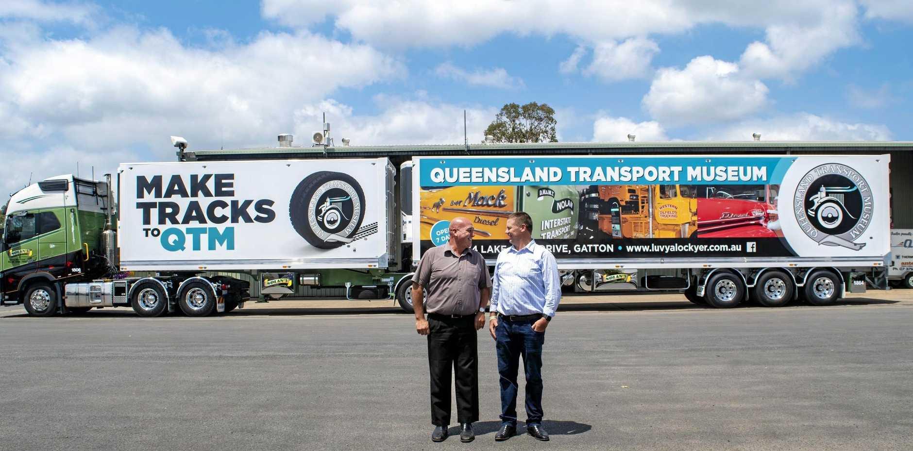 BIG RIG: Nolan's Transport director Flea Nolan with Lockyer Valley Regional Council Deputy Mayor Jason Cook in front of a new Nolan's truck advertising the Queensland Transport Museum.