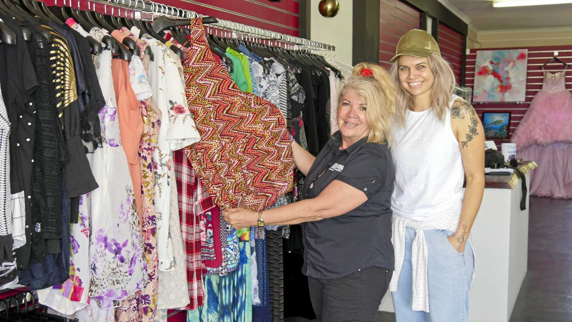 ALL WELCOME: Bayside Transformations CEO Tina Davie and new op shop manager Sotik Sanderson preparing their new store for its official opening on Monday morning.