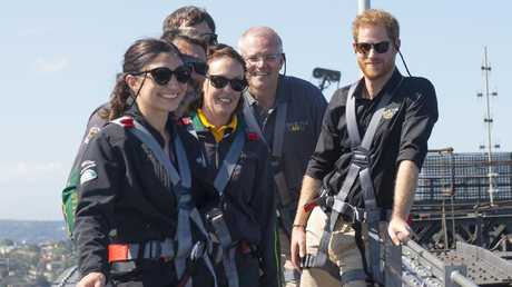 Prince Harry on top of the Sydney Harbour Bridge with members of Australia's team for the Invictus Games, Gwen Cherne and Prime Minister Scott Morrison. Picture: Getty Images