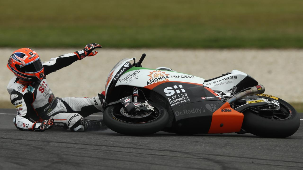 Sam Lowes of Great Britain crashes during Moto2 practice at Phillip Island.