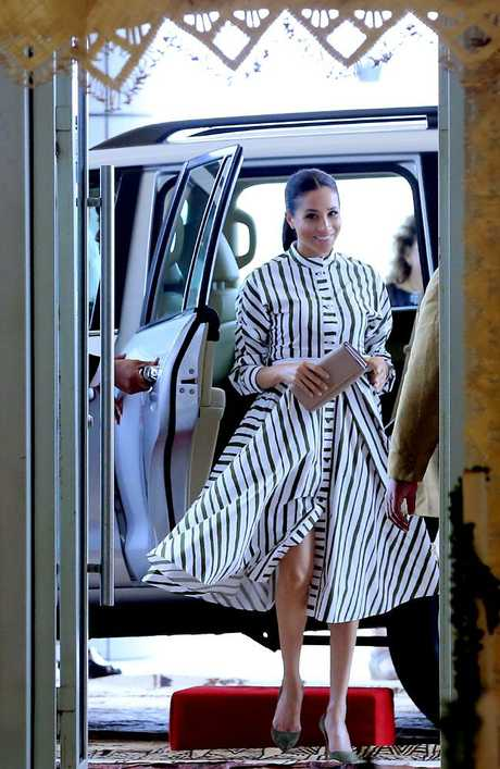 Meghan Markle arrives in a Martin Grant dress on day 11 of the royal tour.