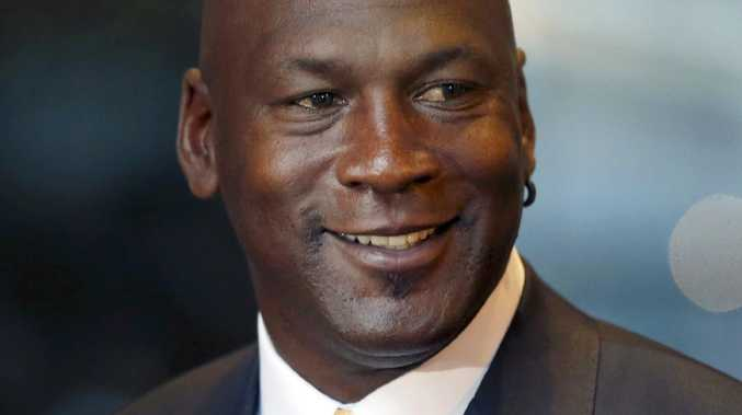 FILE - In this Aug. 21, 2015, file photo, former NBA star and current owner of the Charlotte Hornets, Michael Jordan smiles at reporters in Chicago. A quarter century after being famously excluded from the cult favorite video game NBA Jam, Jordan is investing in esports. Jordan on Thursday, Oct. 25, 2018, was announced as an investor with aXiomatic, a major esports ownership group whose propertie