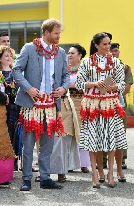 Prince Harry, Duke of Sussex and Meghan, Duchess of Sussex visit an exhibition of Tongan handicrafts, mats and tapa cloths.