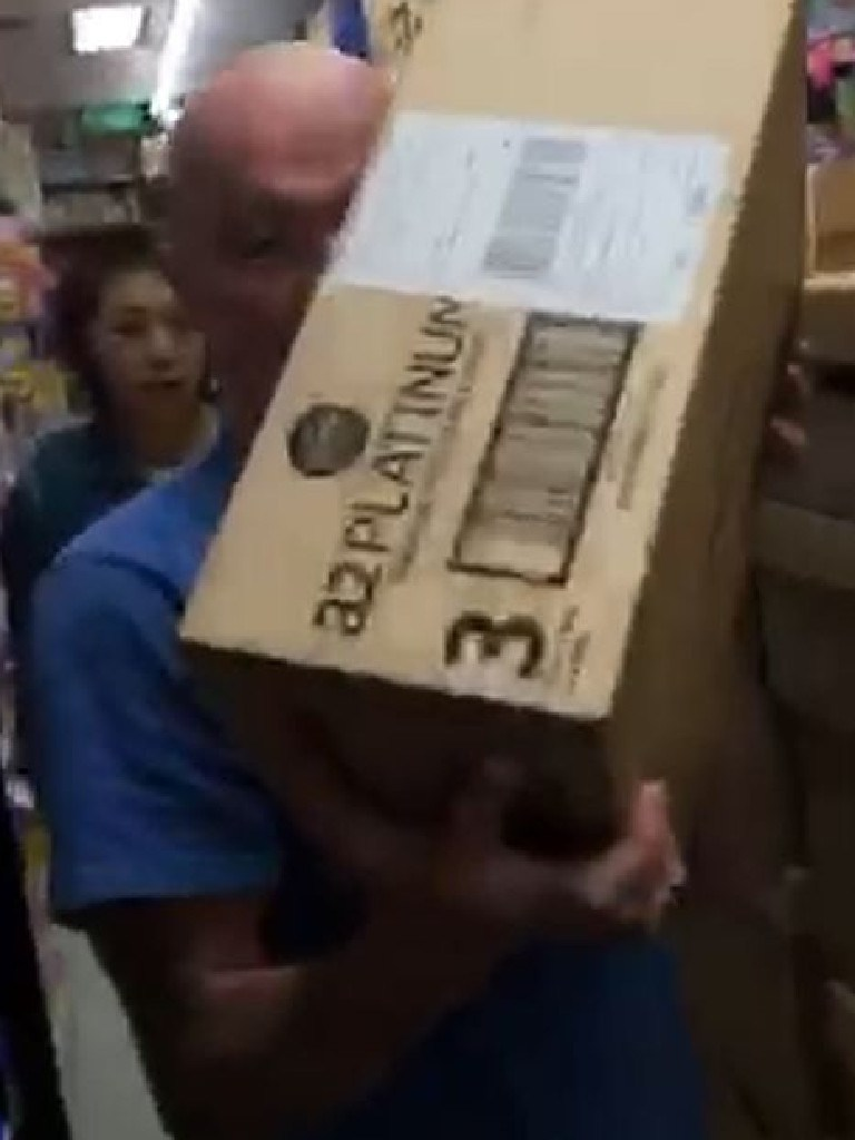 A shopper buying a box of baby formula.