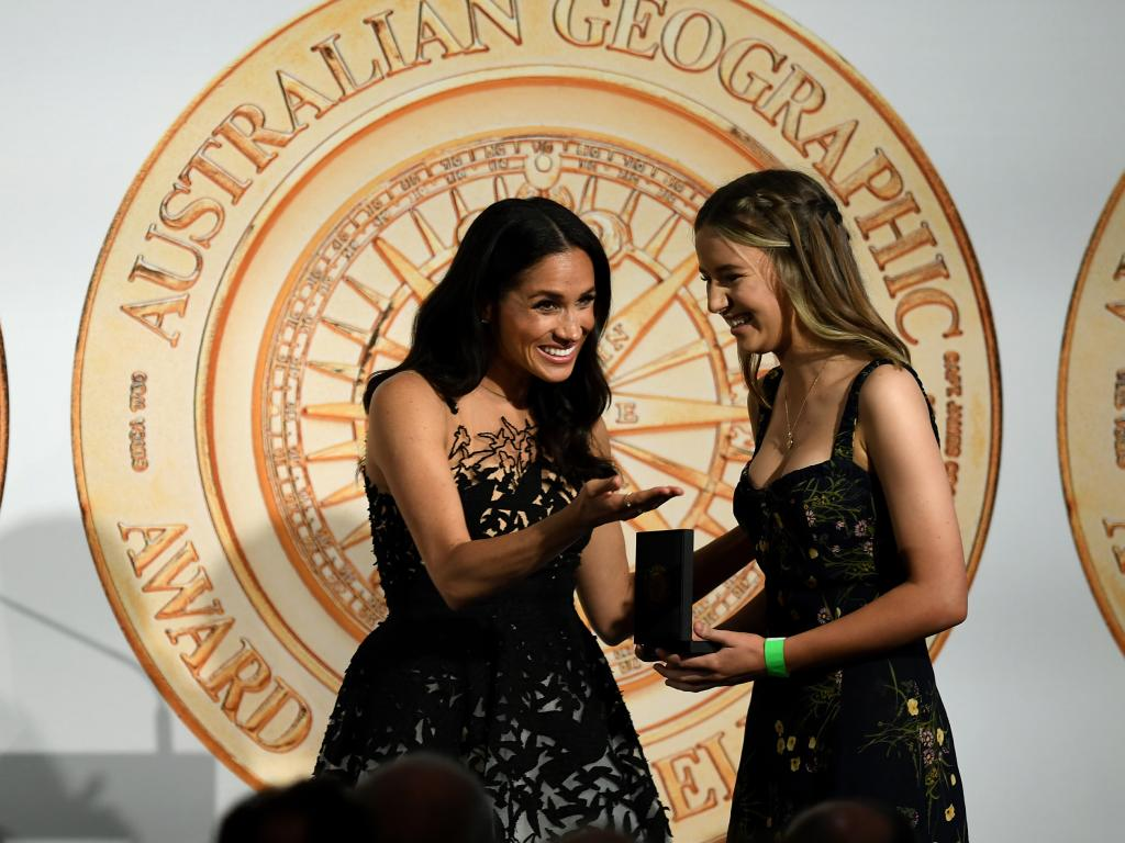 Meghan, the Duchess of Sussex presents the Young Conservationist of the Year award to Sophia Skarparis at the Australian Geographic Society Awards, in Sydney.