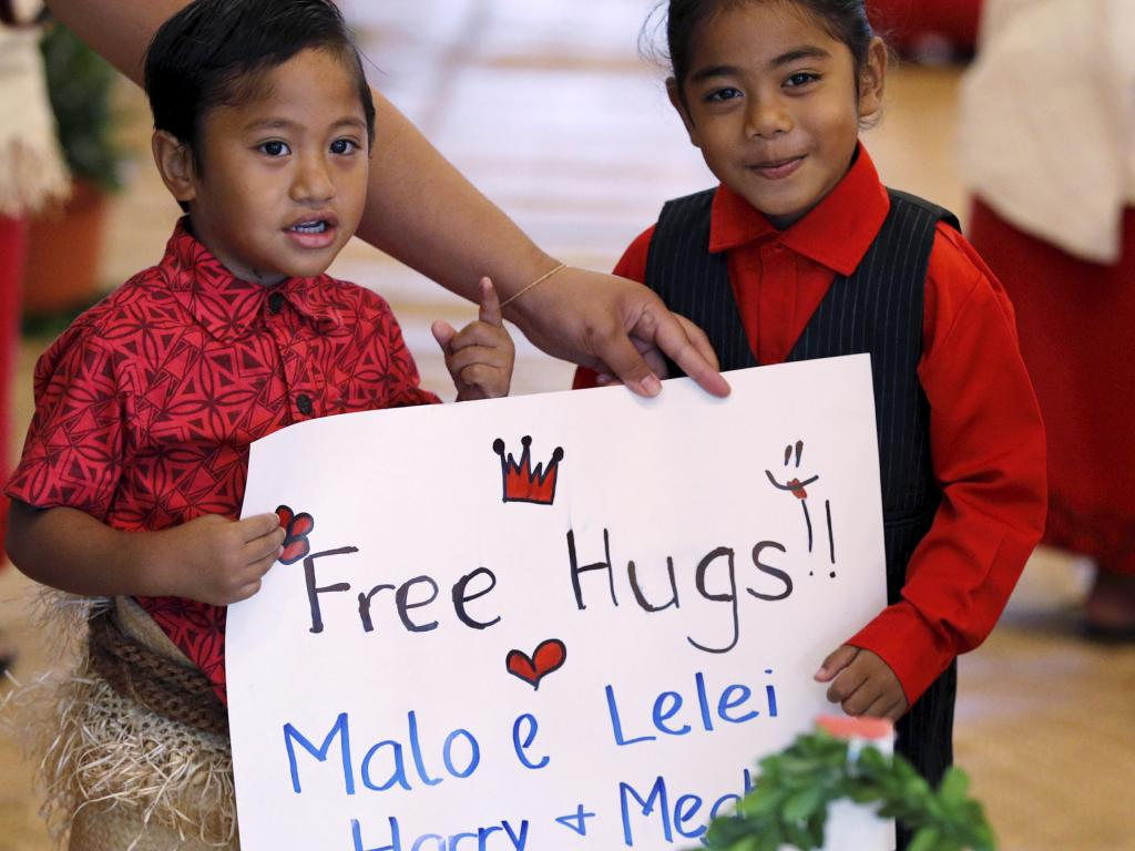 I would pay those children $900 for a hug. Don't devalue yourself, kids. Picture: Phil Nobel/AP