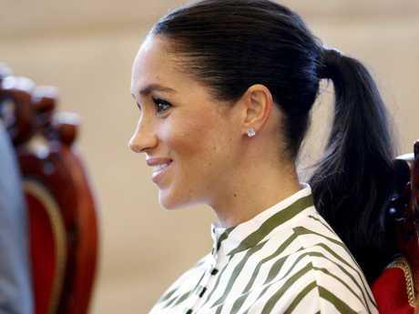 The earrings seem to be the Maison Birks white quartz studs that she often wears. Picture: Phil Nobel/AP