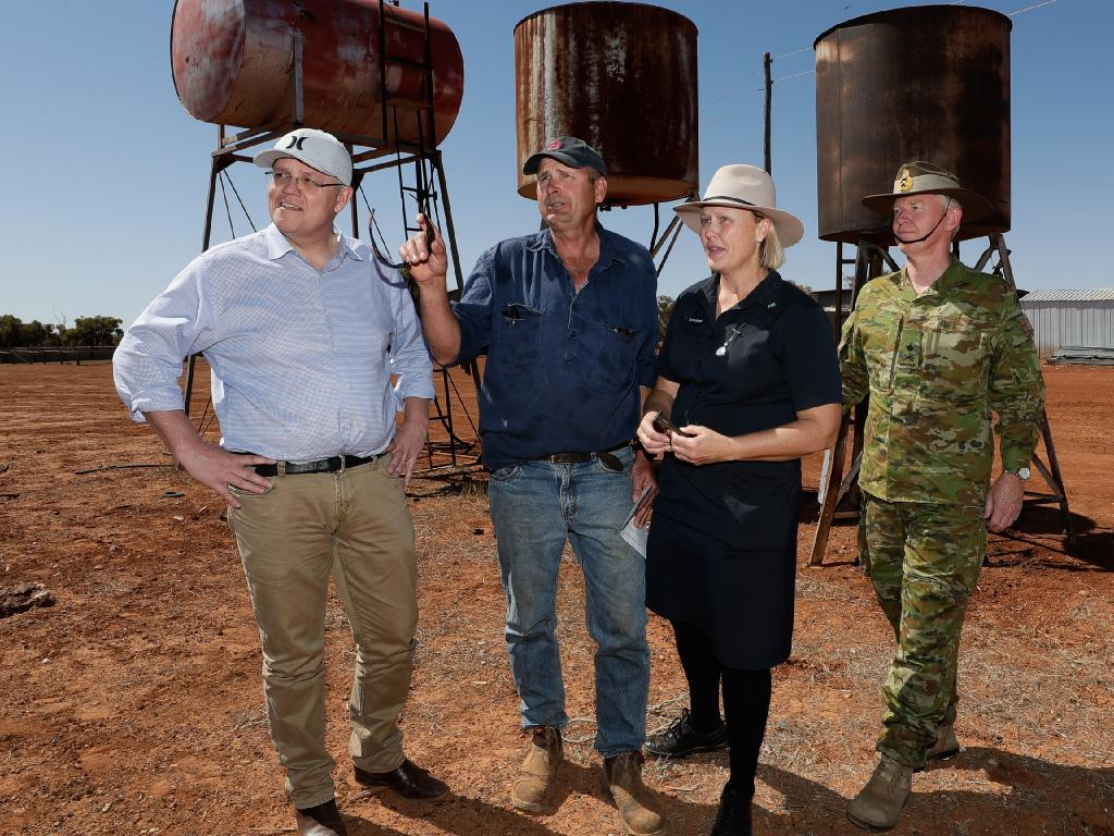Scott Morrison, sheep and cattle graziers Stephen and Annabel Tully and National Drought Coordinator Major-General Stephen Day, during the Prime Minister's tour in Queensland to see the effects of the drought. Picture: Alex Ellinghausen