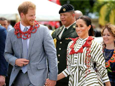 The royal pair walked hand-in-hand as they went to a local market.