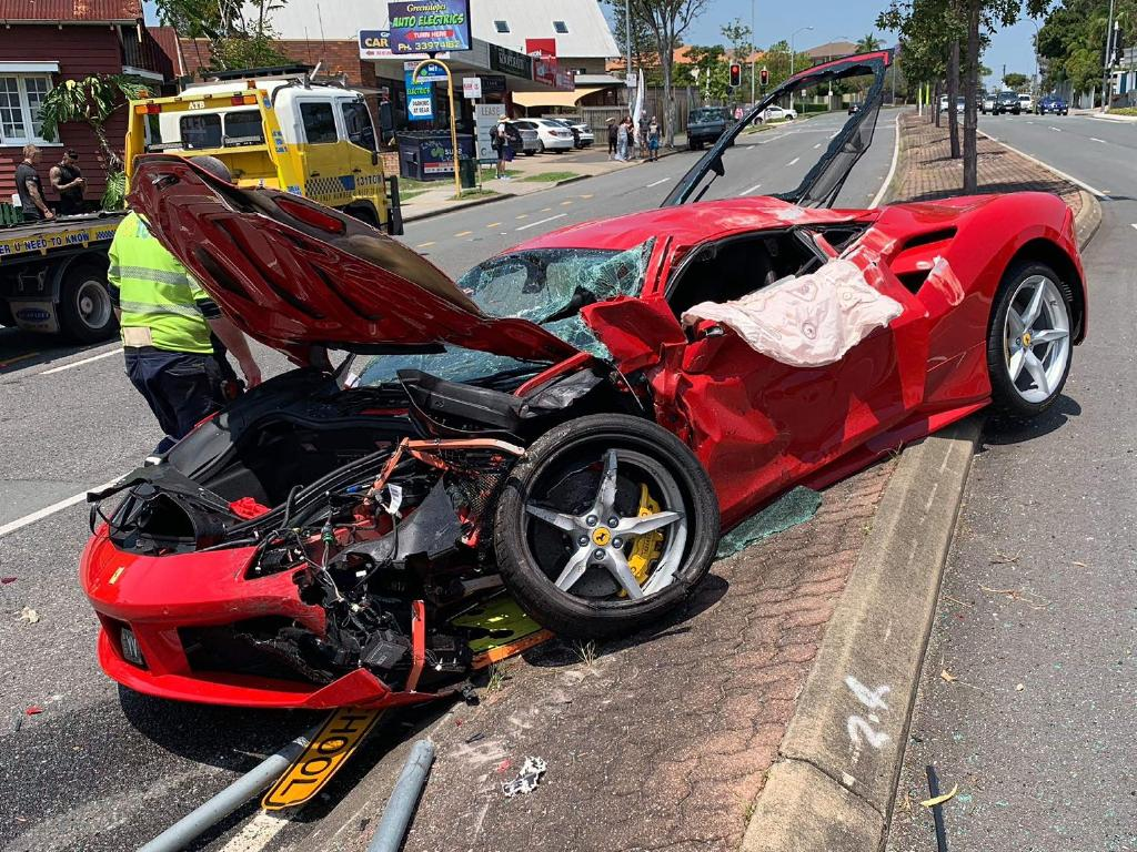 Both the Ferrari and 4WD suffered extensive damage. Picture: Brisbane Alert