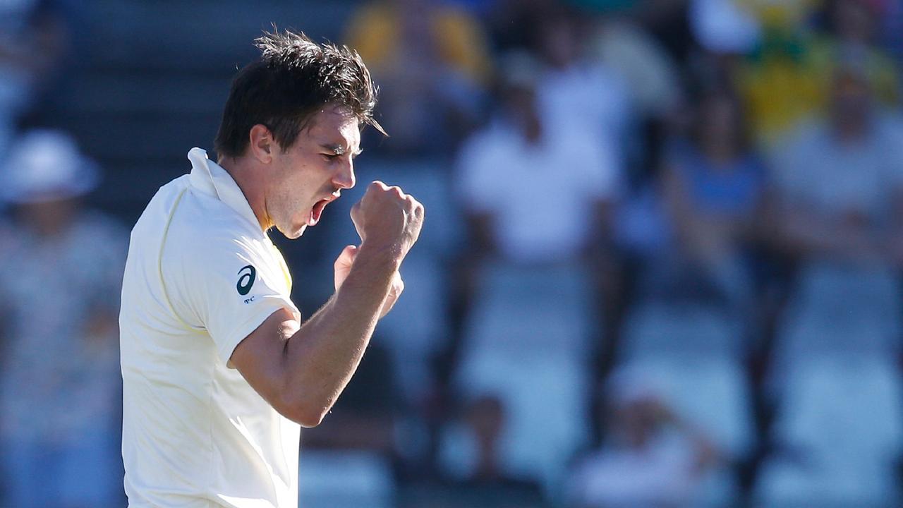 Australian bowler Pat Cummins (L) celebrates the d