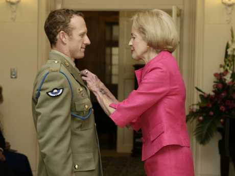 Then Governor-General Dame Quentin Bryce awards Mark Donaldson Australia's highest military honour — The Victoria Cross — in 2009.