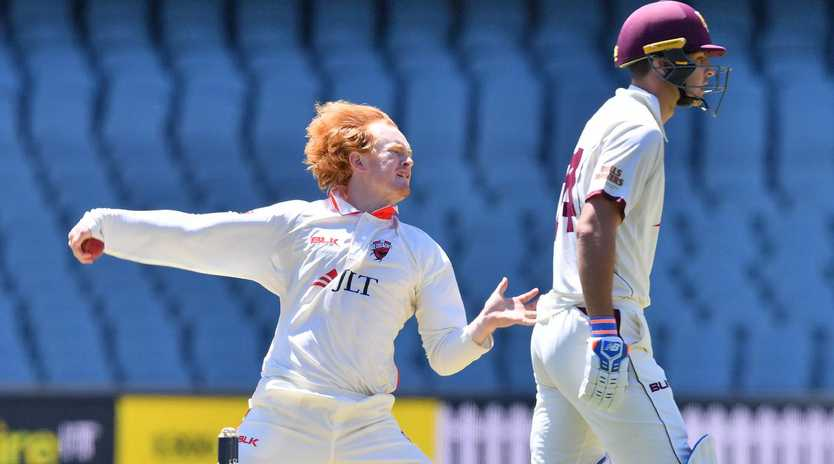 Lloyd Pope of the Redbacks and batsman Jack Wildermuth of the Bulls during day one of the round two JLT Sheffield Shield match between South Australia and Queensland at Adelaide Oval in Adelaide, Thursday, October 25, 2018. (AAP Image/David Mariuz)